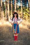 Ukrainian woman in national clothes on the wheat Stock Photos