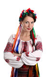 Ukrainian woman in national costume. Portrait of joyful young Ukrainian woman in national costume. Isolated on white background Stock Photo