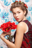 Ukrainian woman with poppy. On flowers background Stock Photography