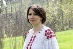 Ukrainian woman. Smiling woman in ukrainian traditional dress royalty free stock images