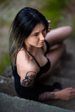 Ukrainian woman with tattoo. A young Ukrainian woman in sexy underwear with a tattoo on her right arm Royalty Free Stock Image