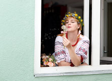 Ukrainian woman in the window Royalty Free Stock Image
