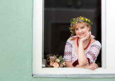 Ukrainian woman in the window Stock Images