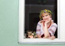 Ukrainian woman in the window Stock Images