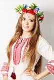 Ukrainian woman in a wreath. Young beautiful Ukrainian woman in a wreath Stock Image