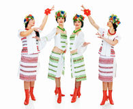 Ukrainian women. Four dancing ukrainian young women on white Stock Image