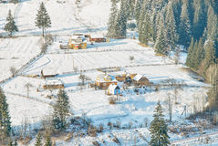Ukrainian wooden rustic houses covered by snow stock image