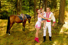 Ukrainians Mom and Dad and daughter in the woods with a horse Stock Photos
