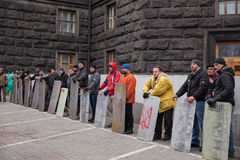 Ukrainians with shields guarding Cabinet of Ministers, Euromaidan Royalty Free Stock Photo