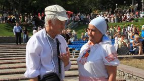 Ukrainians in traditional shirt. Elderly man and woman in ukrainian traditional costume stock video