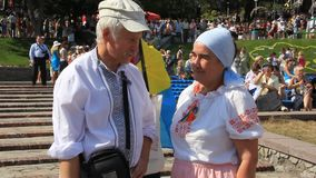 Ukrainians in traditional shirt. Elderly man and woman in ukrainian traditional costume stock video footage