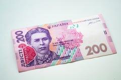 Ukrainien Hryvnia Hryvnia deux cents sur le fond blanc photos stock