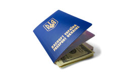 Ukraininan passport with us dollars isolated on white background. Ukrainian passport with us dollars isolated on white background. Concept of success Royalty Free Stock Images