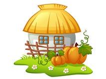 Ukrainisches ländliches Haus mit Bretterzaun und Kürbisen Lizenzfreies Stockfoto