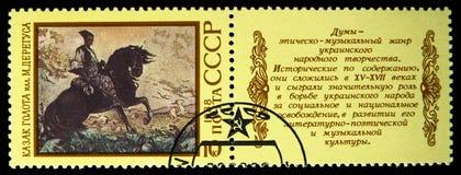 Ukrainsk epos Kosak Golota, se-hyresgäst par, epons av nationer av USSR-serie, circa 1988 royaltyfria bilder