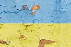 Ukrainsk flagga som målas på en tegelstenvägg flagga ukraine texturerad abstrakt bakgrund Royaltyfri Bild
