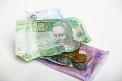 Ukrainsk hryvnia och mynt Royaltyfria Bilder