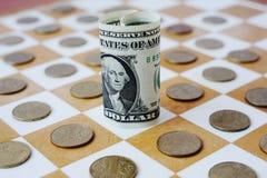 Ukrainsk hryvnia på schackbrädet Royaltyfri Bild