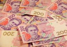 Ukrainska pengar Bakgrund av tvåhundra hryvniasedlar Royaltyfri Fotografi