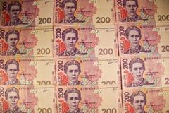Ukrainska pengar Bakgrund av tvåhundra hryvniasedlar Royaltyfri Bild
