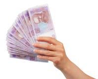 Ukrainska pengar för hryvnia 50 i den kvinnliga handen som isoleras på vit Royaltyfria Bilder