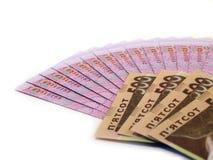 Ukrainska pengar, grivnas på white Arkivbild