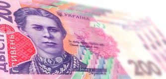 Ukrainska sedlar av hrivna 200 Bakgrund Arkivfoto