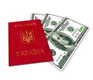 Ukrainskt pass och USA dollar Fotografering för Bildbyråer