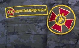 Ukrayina, Kiev, Onafhankelijkheidsvierkant, 24 Augustus: Chevron Nationale Wacht van de Oekraïne, op de vorm van een militair Stock Afbeelding