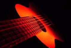 Ukulélé et ficelle de guitare Photos stock
