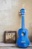 Ukulele against the wall. Ukulele leaning against the wall Stock Images