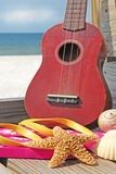 Ukulele and beach items at seashore Stock Image