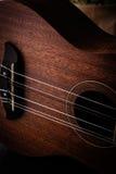 A ukulele on black. Background royalty free stock photography
