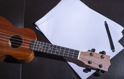 Ukulele and Blank Music Paper Royalty Free Stock Photography
