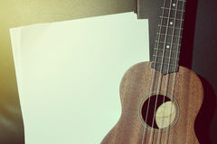 Ukulele and Blank Music Paper. Royalty Free Stock Images