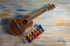 Ukulele with brush and color palette Royalty Free Stock Photo