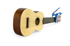 Ukulele  and Capo isolated on white Clipping path included : does not include shadow. Royalty Free Stock Photos