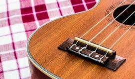 Ukulele. Close up of ukulele on tablecloth Stock Photo