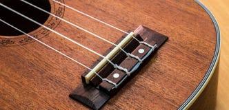 Ukulele. Close up of ukulele on wooden table Stock Photo
