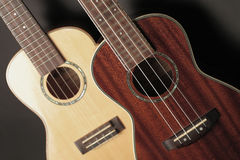 Ukulele. Composition with two ukuleles focus on the ukulele right Stock Images