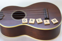 Ukulele Dream square Letter Tiles on white Royalty Free Stock Images