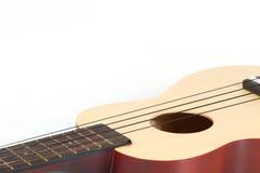 Ukulele-gitarr som isoleras på white. Fotografering för Bildbyråer