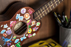 Ukulele. Guitar with nice children stickers Stock Photography