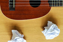 Ukulele guitar with paper scraps Royalty Free Stock Photography