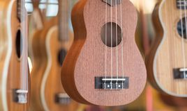 Ukulele guitars for sell at a market. royalty free stock image