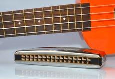 Ukulele and harmonica Royalty Free Stock Photos