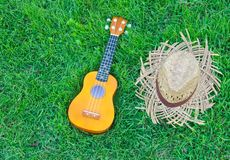 Ukulele with hat Stock Photography
