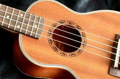 Ukulele Hawaii guitar style. Neck and body part of ukulele Hawaii guitar style royalty free stock photography