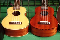 Ukulele Instruments for Sale at a Market. Ukuleles mini guitars on sale at an outdoor stall Royalty Free Stock Photo
