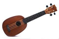 Ukulele on isolated background. Wooden ukulele on isolated background Royalty Free Stock Photo